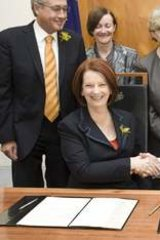 The Greens sign a deal in support of the Australian Labor Party in Julia Gillard's office at Parliament House.