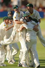 Victory! Australian players celebrate after narrowly avoiding a draw.