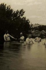 Photo by E.T Luke of Senators bathing in the Snowy River at Dalgety.