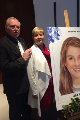 Victorian couple Jim and Cathy McDougall with an aged-progressed image of their missing grand-daughter Leela, who would now be 15. Leela and her mother, Chantelle, have been missing for almost a decade.