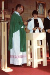 Father Victor Rubeo officiating at the baptism of Mr Hersbach's youngest daughter in 1983.