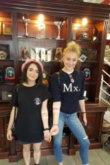 Sansa and Arya Stark show off their matching tattoos in Belfast, Northern Ireland.