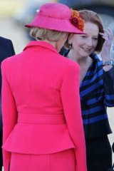 Royal greeting … the Queen with Julia Gillard, centre, and Quentin Bryce at Fairbairn RAAF base yesterday.