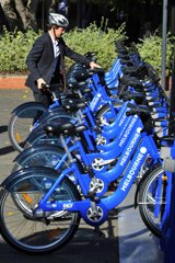 A rider at the Melbourne Bike Share scheme station at Melbourne University.