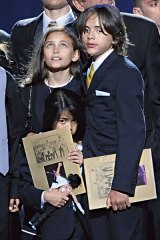 Paris, Prince and Blanket at their father's funeral.
