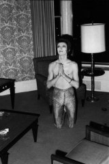 David Bowie in his hotel room before a performance at the Auditorium Theatre, Chicago, October 7, 1972. ''He was always a very playful personality and this spoof praying gesture was a typical moment,'' says Rock. 'Note the cigarette in his left hand.'