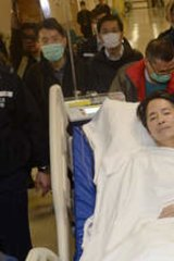 Former Ming Pao editor Kevin Lau, after he was attacked in the street with a meat cleaver.