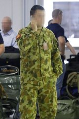 Departure: Over 80 troops checked through Sydney Airport's commercial terminal en route to Iraq.