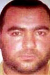 "A US State Department ""wanted"" image of the man known as Abu Bakr al-Baghdadi, the leader of ISIL."