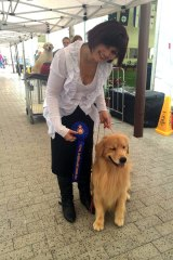 Dog trainer Anthea Adamopoulos with James, who won Best Golden Retriever at the 2014 Ekka.