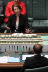 Prime Minister Julia Gillard and Opposition Leader Tony Abbott during question time yesterday.