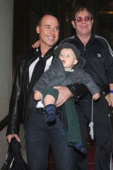 Happy family ... David Furnish and Elton John with their son Zachary.