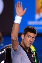 See you in 2015: Novak Djokovic walks off sadly.