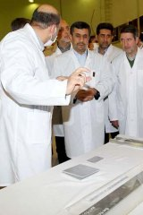 President Mahmoud Ahmadinejad listens to an expert during a tour of Tehran's research reactor.