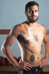 Getting the jab done … diabetic Sam Reid shows his insulin-injection target; inset, the dartboard tattoo.