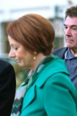 Prime Minister Julia Gillard (left) with Damien and Rae Panlock, parents of bullying victim Brodie.