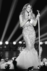 In her element: Mariah Carey performs on <i>American Idol</i>, on which she's also a judge.