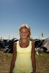 A young woman attends the Roskilde Festival in Denmark.