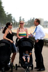 Abbott chats with Manly locals Meg Garrido and Zoe Whitcomb.