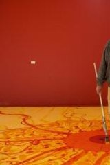 Creature of contradiction: John Olsen working on a mural at his Southern Highlands home in 2013.