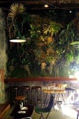 Blaze … the green wall at Arcadia Liquors caught alight.