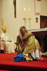 Bishop Michael Hough smashes his precious chalice.