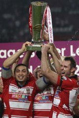Winning Warriors . . .Wigan players celebrate their victory.