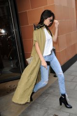 Skinny jeans are the duster's friend, as demonstrated by Kendall Jenner.