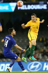 Socceroo Mark Milligan in action against Greece last year.
