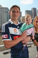 Mark Milligan poses with his daughters, Maya and Audrey, and his wife, Rhia Milligan, in Melbourne on Tuesday.