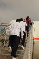 Sri Lankan men leaving Christmas Island for Colombo last week. They were followed by a second voluntary group yesterday.
