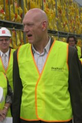 Battman ... Federal Environment Minister Peter Garrett receives a tour of the Bradford insulation plant in Brisbane today.