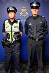 Constable Elizabeth Tonkin and Senior Sergeant Andrew Falconer model the new navy blue Victoria Police uniforms.