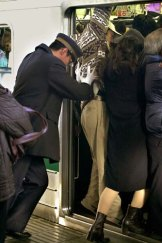 On you get … a Tokyo attendant pushes in commuters.