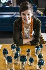 Canberra Glassworks artist-in-residence Emilie Patteson with the piece <em>Mushrooms</em>, created with Annika Romeyn.