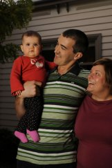 Tim and Liz Spelman, at home in Yarraville  with daughter Lucy,  fall between many of the budget's target groups.