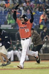 Cult hero Jack Murphy shows his elation after hitting an eighth-inning grand slam.