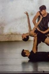 Todd Sutherland, Jesse Scales, and Sam Young-Wright (standing) perform in the Sydney Dance Company's Frame of Mind.