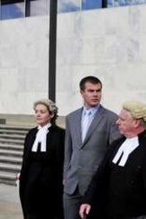 McDonald, second from left, and Deblaquiere, right, leave the ACT Magistrates Court after being found guilty.