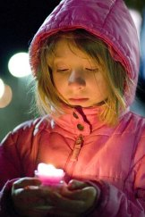 A girl participates in a vigil in support of those killed and injured in the bombings at the Boston Marathon.