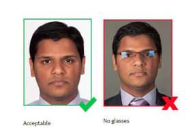 Australia to ban glasses from passport photos