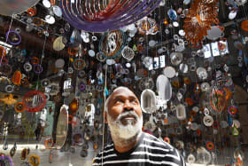Nick Cave with his huge installation, Kinetic Spinner Forest.