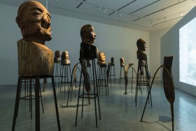 Kader Attia's J'Accuse 2016 teak, steel rebar, single-channel digital video, projection, colour, sound dimensions variable courtesy the artist and Galerie Nagel Draxler, (Berlin/Cologne).
