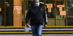 CFMEU official Darren Greenfield leaving Sydney Police Centre.