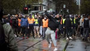 A protester throw a projectile at Victorian Police.