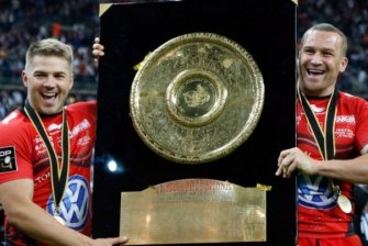 Winners are grinners: Drew Mitchell and Matt Giteau after winning a title for Toulon.