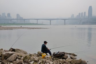 A Chongqing resident fishes on the Yangtze.