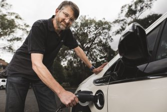 Peter Campbell charging his hybrid Holden Volt.