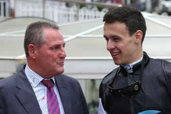 Trainer Grahame Begg talks with jockey Jordan Childs, who rode Written By to victory in the Ladbrokes Blue Diamond Prelude at Caulfield Racecourse.