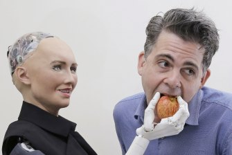 Sophia, a lifelike robot at the forefront of artificial intelligence, with its creator David Hanson.